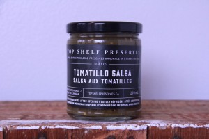 270mL glass jar of Tomatillo Salsa with a black label and lid